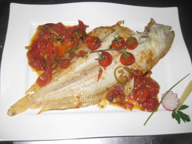 Fisch mit Tomatenragout